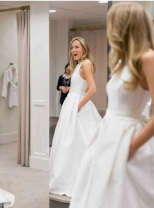 A-Line Round Neck Criss Cross Satin Wedding Dress with Bowknot Pockets